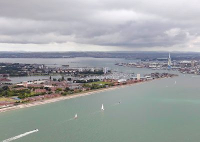 Sailing into Portsmouth Harbour past Haslar shoreline