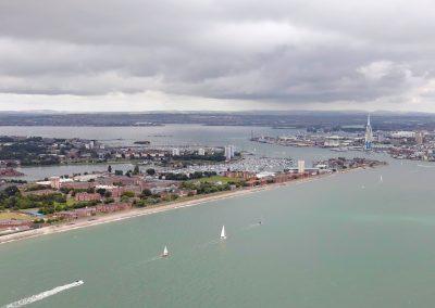 Sailing into Portsmouth Harbour past Haslar shoreline