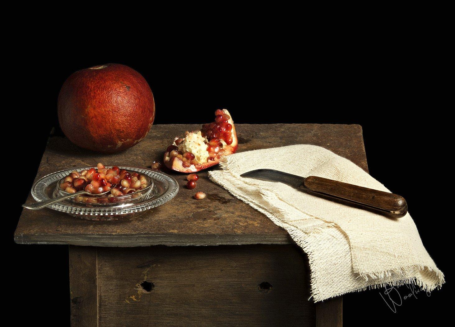 pomegranate on slate - still life