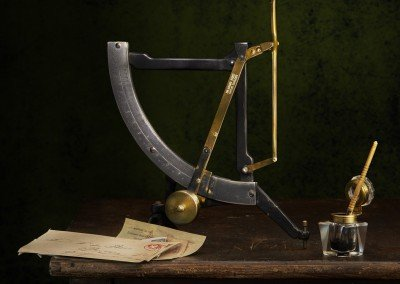 Light painted Indonesian letter scales with glass inkwell, pen and correspondence.